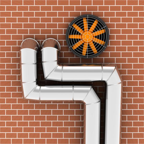 трубы и вентилятор в стене